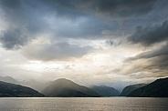 Misty mountains across the sea