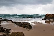 Waves crashing against rocks.