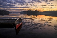 Sunrise and the red canoe