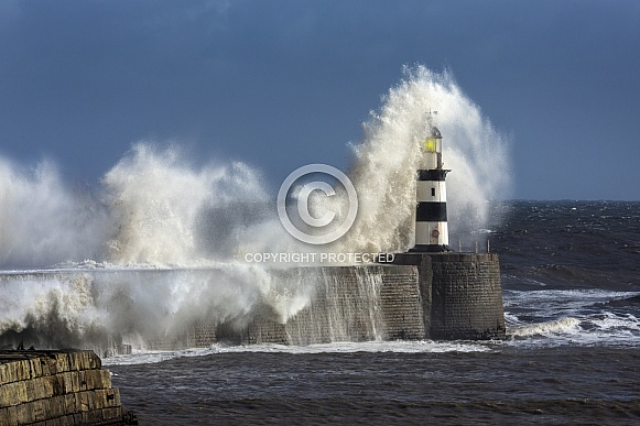 Waves crashing over Seaham Lighthouse