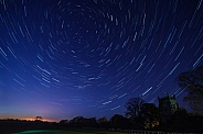 Star Trails above a village in North Yorkshire - England