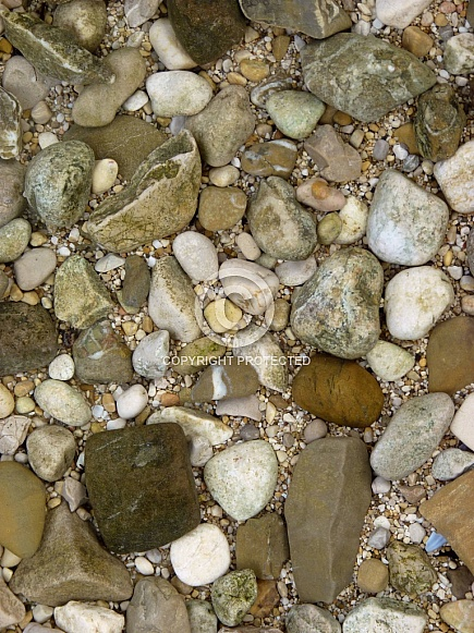 Pebbles under crystal clear water