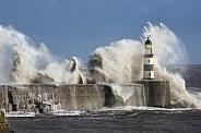 Waves crashing over Seaham Lighthouse